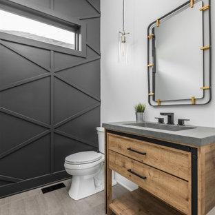 インディアナポリスの中くらいのモダンスタイルのおしゃれなトイレ・洗面所 (オープンシェルフ、茶色いキャビネット、セラミックタイルの床、コンクリートの洗面台、グレーの床、グレーの洗面カウンター、独立型洗面台、板張り壁) の写真