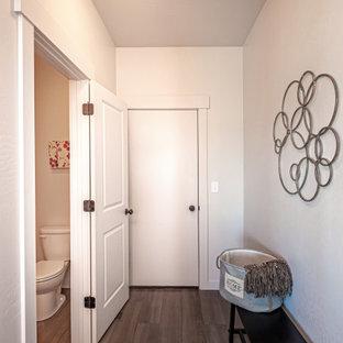 На фото: со средним бюджетом маленькие туалеты в стиле современная классика с фасадами в стиле шейкер, темными деревянными фасадами, раздельным унитазом, серыми стенами, полом из ламината, накладной раковиной, столешницей из ламината, серым полом и серой столешницей