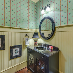 Inspiration for a country cloakroom in Atlanta with a submerged sink, multi-coloured walls, dark hardwood flooring, glass-front cabinets and dark wood cabinets.