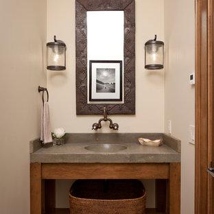 Ispirazione per un piccolo bagno di servizio chic con pareti beige, lavabo a colonna, top in cemento, nessun'anta, ante in legno scuro e lastra di pietra