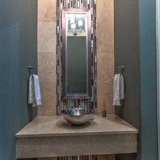 На фото: туалет среднего размера в стиле современная классика с стеклянной плиткой, полом из травертина, настольной раковиной, столешницей из травертина, коричневой плиткой, разноцветной плиткой, серыми стенами и коричневым полом с
