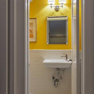 Esempio di un piccolo bagno di servizio chic con piastrelle bianche, piastrelle in ceramica, pareti gialle, lavabo sospeso e pavimento in marmo