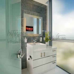 Inspiration for a contemporary powder room remodel in Miami