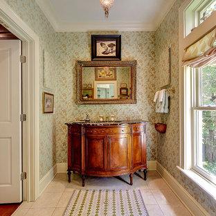 На фото: туалет в классическом стиле с врезной раковиной, фасадами островного типа, фасадами цвета дерева среднего тона и разноцветными стенами