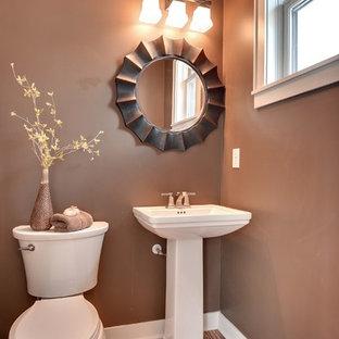 Esempio di un bagno di servizio classico con lavabo a colonna