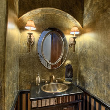 Mediterranean Powder Room by Vanguard Studio Inc.