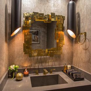 На фото: маленький туалет в современном стиле с коричневыми стенами, монолитной раковиной, столешницей из искусственного камня и серой столешницей с