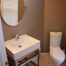 Modern Powder Room by Xtreme Painting & Remodeling, LLC