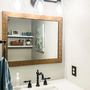 На фото: маленький туалет в стиле современная классика с темными деревянными фасадами, серыми стенами, полом из бамбука, врезной раковиной, мраморной столешницей, коричневым полом, белой столешницей и напольной тумбой с