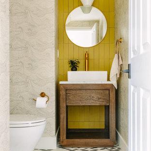 サンフランシスコの中くらいのコンテンポラリースタイルのおしゃれなトイレ・洗面所 (家具調キャビネット、中間色木目調キャビネット、黄色いタイル、グレーの壁、ベッセル式洗面器、白い床、白い洗面カウンター) の写真