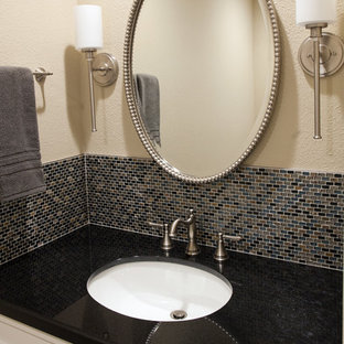 Photo of a small classic cloakroom in San Francisco with shaker cabinets, white cabinets, a two-piece toilet, multi-coloured tiles, glass sheet walls, beige walls, slate flooring, a submerged sink, granite worktops and multi-coloured floors.