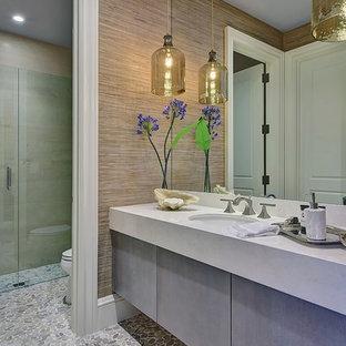 На фото: класса люкс огромные туалеты в стиле современная классика с плоскими фасадами, серыми фасадами, мраморной столешницей, унитазом-моноблоком, полом из галечной плитки, врезной раковиной и серой плиткой
