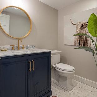 На фото: со средним бюджетом маленькие туалеты в стиле современная классика с фасадами с утопленной филенкой, синими фасадами, раздельным унитазом, серыми стенами, полом из керамогранита, накладной раковиной, мраморной столешницей, серым полом и белой столешницей