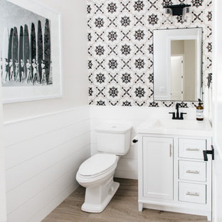 Inspiration for a classic cloakroom in Phoenix with shaker cabinets, white cabinets, a two-piece toilet, multi-coloured tiles, grey walls, medium hardwood flooring, brown floors and white worktops.