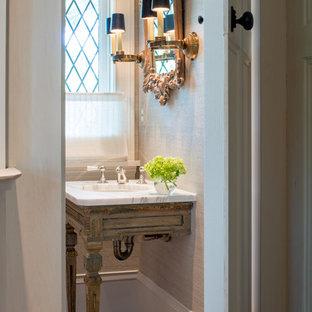 Foto di un bagno di servizio classico con lavabo sottopiano e top bianco