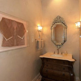 Photo of a small traditional cloakroom in Houston with a submerged sink, freestanding cabinets, dark wood cabinets, marble worktops, a one-piece toilet, multi-coloured tiles, grey walls and terracotta flooring.