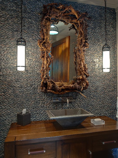Example of a mountain style pebble tile powder room design in Atlanta with  a vessel sink