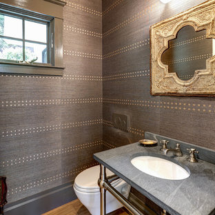 На фото: маленький туалет в стиле современная классика с инсталляцией, коричневыми стенами, светлым паркетным полом, накладной раковиной, столешницей из талькохлорита, коричневым полом и черной столешницей с