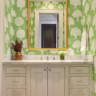 Photo of a classic cloakroom in Houston with beaded cabinets, white cabinets, marble worktops and green walls.