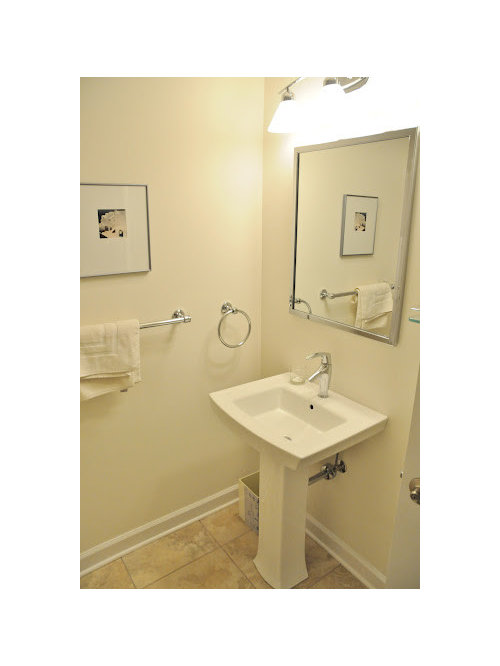 Example Of A Small Classic Travertine Floor Powder Room Design In Baltimore  With A One