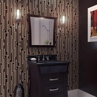 Ejemplo de aseo asiático con armarios tipo mueble, puertas de armario de madera en tonos medios, encimera de granito, baldosas y/o azulejos grises, suelo de baldosas de porcelana y paredes multicolor