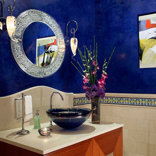 Photo of a medium sized traditional cloakroom in Orange County with raised-panel cabinets, medium wood cabinets, multi-coloured tiles, mosaic tiles, blue walls, ceramic flooring, a vessel sink, concrete worktops and white floors.