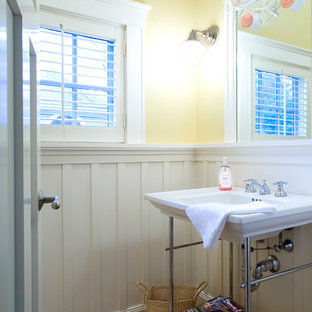 Arts and crafts powder room photo in Boston with a console sink