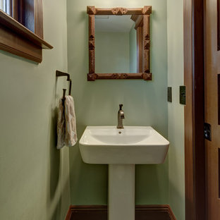 Small arts and crafts slate floor powder room photo in New York with a two-piece toilet, green walls and a pedestal sink