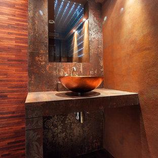 Ejemplo de aseo de estilo zen, de tamaño medio, con sanitario de pared, baldosas y/o azulejos multicolor, baldosas y/o azulejos de porcelana, parades naranjas, suelo de baldosas de porcelana y lavabo sobreencimera
