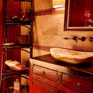 Foto de aseo de estilo zen, pequeño, con lavabo sobreencimera, armarios tipo mueble, encimera de madera, baldosas y/o azulejos de vidrio y puertas de armario con efecto envejecido