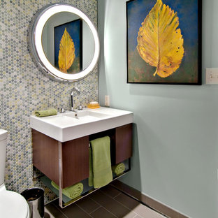 Inspiration for a 1960s multicolored tile and mosaic tile powder room remodel in Minneapolis with an integrated sink, open cabinets and a two-piece toilet