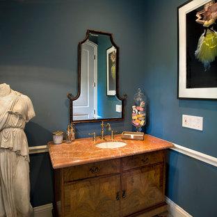 На фото: туалет в стиле современная классика с врезной раковиной, фасадами островного типа, фасадами цвета дерева среднего тона и оранжевой столешницей с
