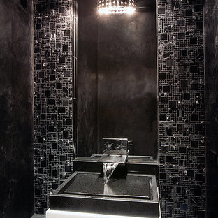Inspiration for a small modern black tile marble floor powder room remodel in Atlanta with a vessel sink, marble countertops and black walls