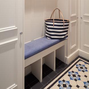 Immagine di un piccolo bagno di servizio moderno con nessun'anta, ante bianche, pavimento in terracotta, pavimento blu e mobile bagno incassato