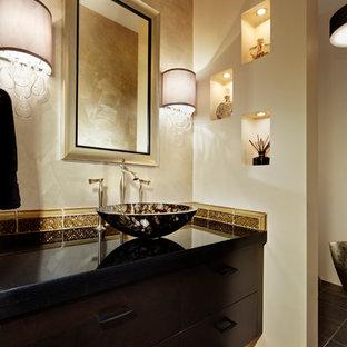 На фото: туалет среднего размера в современном стиле с плоскими фасадами, темными деревянными фасадами, унитазом-моноблоком, стеклянной плиткой, разноцветными стенами, полом из сланца, столешницей из гранита и настольной раковиной с