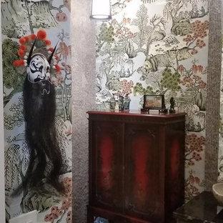 Foto de aseo de estilo zen, pequeño, con armarios con paneles lisos, puertas de armario grises, sanitario de una pieza, baldosas y/o azulejos beige, baldosas y/o azulejos de piedra, suelo de piedra caliza, lavabo sobreencimera, encimera de mármol, suelo beige y encimeras negras