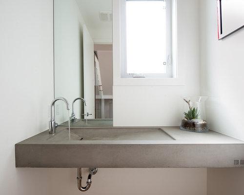 Foton och inspiration för moderna toaletter, med bänkskiva i betong