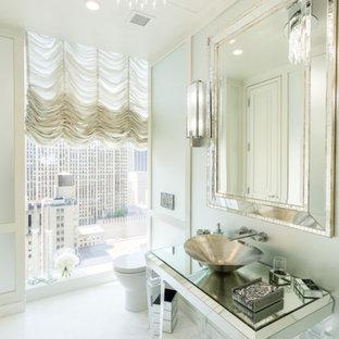 Неиссякаемый источник вдохновения для домашнего уюта: туалет среднего размера в стиле современная классика с стеклянными фасадами, унитазом-моноблоком, белой плиткой, стеклянной плиткой, мраморным полом, настольной раковиной, стеклянной столешницей и белым полом