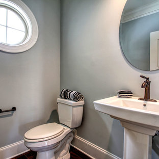 Large beach style dark wood floor powder room photo in Other with a pedestal sink