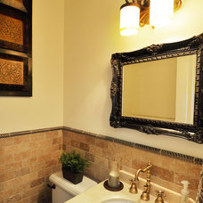 Mediterranean Powder Room by Javic Homes