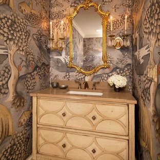 Design ideas for a mid-sized traditional powder room in Chicago with an undermount sink, beige cabinets, multi-coloured walls, furniture-like cabinets, ceramic floors, engineered quartz benchtops, beige floor and brown benchtops.