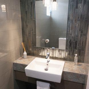 パースのモダンスタイルのおしゃれなトイレ・洗面所 (茶色いキャビネット、ラミネートカウンター、フラットパネル扉のキャビネット、グレーのタイル、セラミックタイル、マルチカラーの洗面カウンター、ペデスタルシンク) の写真