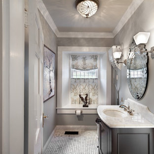 Example of a large classic black and white tile marble floor and multicolored floor powder room design in DC Metro with furniture-like cabinets, dark wood cabinets, gray walls, an undermount sink, marble countertops and white countertops