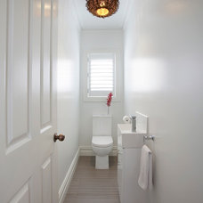 Contemporary Powder Room by Pepper Constructions