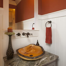 rustic powder room by Brookstone Builders