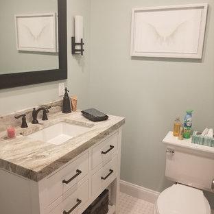 ニューヨークの小さいコンテンポラリースタイルのおしゃれなトイレ・洗面所 (フラットパネル扉のキャビネット、白いキャビネット、分離型トイレ、緑の壁、セラミックタイルの床、オーバーカウンターシンク、ラミネートカウンター、白い床、ベージュのカウンター) の写真