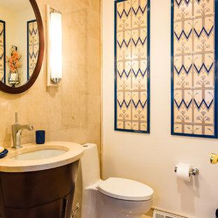 Ejemplo de aseo de estilo zen, de tamaño medio, con suelo beige, armarios con paneles lisos, puertas de armario de madera en tonos medios, sanitario de una pieza, baldosas y/o azulejos beige, baldosas y/o azulejos de porcelana, paredes beige, suelo de baldosas de porcelana, lavabo con pedestal, encimera de cuarzo compacto y encimeras beige