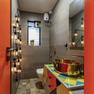 Foto de aseo ecléctico con armarios con paneles lisos, baldosas y/o azulejos grises, suelo de azulejos de cemento, lavabo sobreencimera, suelo multicolor y encimeras multicolor