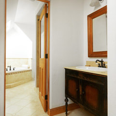 traditional powder room by the finishing company-Kaiser Homes