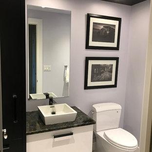 На фото: класса люкс маленькие туалеты в стиле модернизм с плоскими фасадами, белыми фасадами, раздельным унитазом, фиолетовыми стенами, полом из керамической плитки, раковиной с пьедесталом, столешницей из гранита и бежевым полом